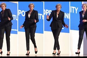 British PM Theresa May dances to Dancing Queen at Tory party conference