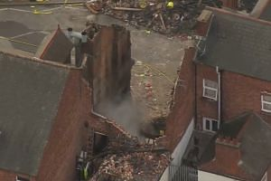 Ruined shop still smoking after blast kills four in UK's Leicester