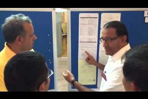 PAP's S. Iswaran pointing out something on RP's Kenneth Jeyaretnam's form