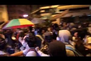 Protesters in Hong Kong retaliated by opening umbrellas and charging at police