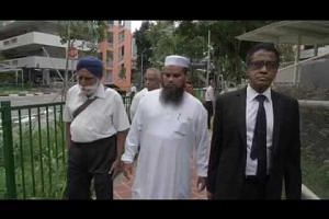Imam Nalla Mohamed Abdul Jameel leaves the State Courts