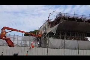 Worker drilling both ends of failed viaduct on July 18