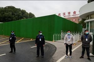 WHO team in Wuhan head for hospital