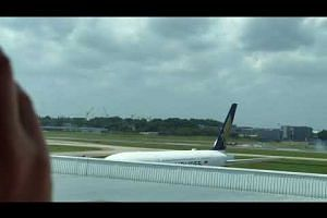 An aircraft from The Black Eagles skids and crashes into the grass at Changi Airport