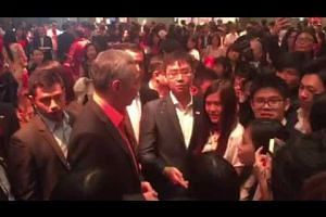 PM Lee speaking with Singaporean students