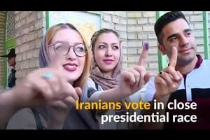 Iranians cast votes in close presidential election
