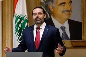 Lebanon's Hariri resigns as crisis turns violent
