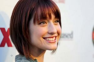 Smallville actress Allison Mack charged in self-help guru's sex traffic case