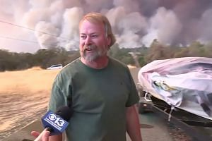 Town destroyed, thousands flee Calif. wildfires