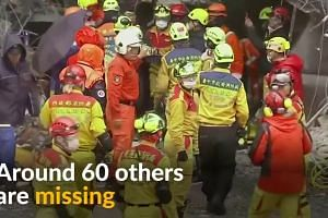 Rescuers search through rubble after Taiwan quake