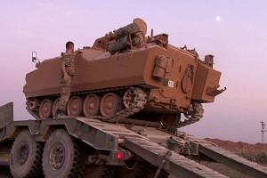 Turkey presses offensive in Syria, Erdogan hits out at critics