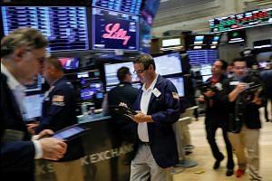 Wall Street ends higher on strong jobs data