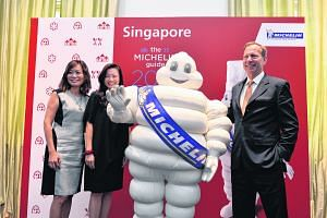 (From left) Ms Michelle Ling, director of Robert Parker Wine Advocate; Ms Melissa Ow, deputy chief executive of Singapore Tourism Board; the Michelin man; and Mr Michael Ellis, international director of Michelin Guides.