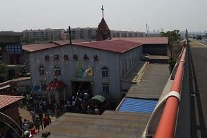 Worshippers entering the independent Zhongxin Bridge Catholic Church in Tianjin. Conditions for underground churches have worsened in recent years, compared with state-run churches.