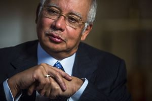 The options may be dwindling for Mr Najib (left). The WSJ report alleged that documents from a
