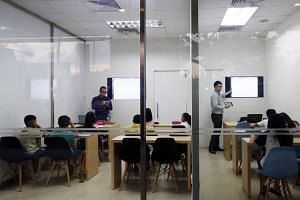 """A survey of 500 parents, conducted by The Straits Times and research company Nexus Link, found that only a third agreed that tuition actually pulled up academic performance by """"a noticeable extent""""."""
