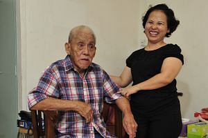 Ms Noriza A. Mansor with Mr Tan Soy Yong at his home. She still visits the elderly man on her days off to look after him. Readers were touched by the story of how Ms Noriza helped Mr Tan in a supermarket after he had soiled his pants while shopping w