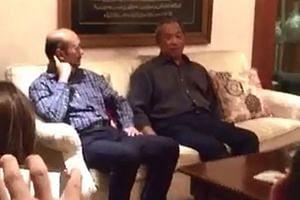 Tan Sri Muhyiddin Yassin with Kedah Menteri Besar Mukhriz Mahathir (left) in an image from the video. Former minister Kadir Sheikh Fadzir was also present at the meeting.