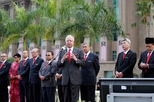 Malaysian Prime Minister Najib Razak speaking at the Prime Minister's Office's monthly assembly in Putrajaya yesterday. Former premier Mahathir Mohamad was quick to refute claims that it was Umno practice for its presidents to hold the ruling party's