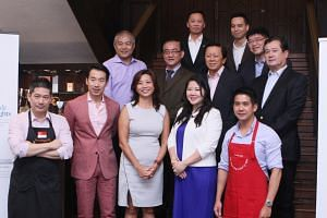 The panel of The Business Times Wine Challenge 2015 - CEOs' Choice, who include chief judge Lim Hwee Peng (front row, far left) and Les Amis wine director Timothy Goh (front row, left).