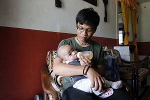 SMRT technical officer Muhamad Shah Rizal Hassan, 28, took a second week of paternity leave in September to spend more time with his four-month-old son, Muhamad Shafi Rayhan. More companies have taken up the Government's call to double paternity leav