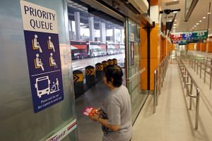 (Far left) Brightly coloured signs mark out priority zones near the boarding berths at the Joo Koon Integrated Transport Hub, which opens on Saturday. The zones have seats for the elderly and those in need as well as tactile paving to help the visual