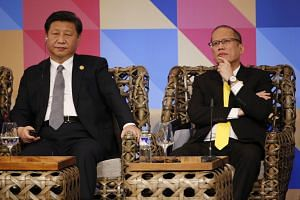 China's President Xi Jinping (left) and the Philippines' President Benigno Aquino listening to the Apec Business Advisory Council dialogue at the Apec Summit in Manila yesterday.