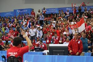 Table tennis singles Class 2 silver medallist Jason Chee saluting the near full house at OCBC Arena Hall 1, which gave him a standing ovation for his dogged fight in the 2-3 loss to Thailand's Natthawut Thinathet in their final round-robin clash. For