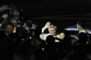 Dr Tony Tan with his wife, Mrs Mary Tan, at the Toa Payoh Stadium on Aug 27, 2011. The results later showed that he had won the Presidential Election.
