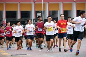Students and teachers push one another on while running as far as they can within an hour at Serangoon Junior College's annual event, Will Run.
