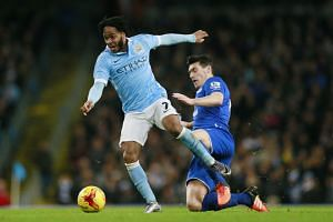 Manchester City's Raheem Sterling (left) in action against Everton's Gareth Barry in their League Cup semi-final. He will face Liverpool in the final today and Pellegrini says that although it is never easy to play against a former club, Sterling is