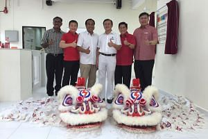 The People's Action Party's Hougang candidate Lee Hong Chuang (fourth from left) with the ruling party's Aljunied GRC team members (from left) K. Muralidharan Pillai, Victor Lye, Shamsul Kamar, Yeo Guat Kwang and Chua Eng Leong at a Chinese New Year