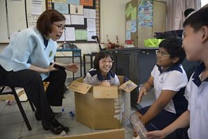 Mayflower Primary School maths teacher Jessie Ching discussing the design process behind circular props made by her pupils. Experts believe that through drama, knowledge is no longer something students simply memorise but something they understand th