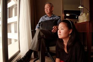 Jemima Yong (right), with her grandfather Joseph Yong, who died in 2014, aged 84