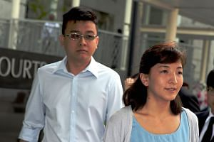 Takagi arriving at the court yesterday with her husband, Yang. Takagi, who is eight weeks pregnant, apologised to Singaporeans for the harm the articles had caused.
