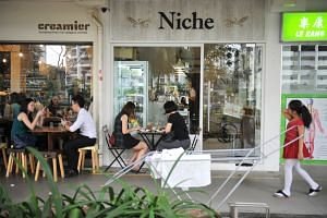 Trendy cafes located near a busy market in Toa Payoh Lorong 1. More help can be given to businesses located in HDB estates to enliven them, MPs said.
