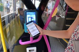 Even though NFC technology can now be used in mobile phones to tap for payment on buses and trains, there remain some snags, including the card reader's sensor being unable to detect the chip (left) unless the phone is very near the reader.