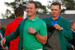 Jordan Spieth presenting Danny Willett with the green jacket after the Englishman won the final round of the Masters in only his second appearance at Augusta.