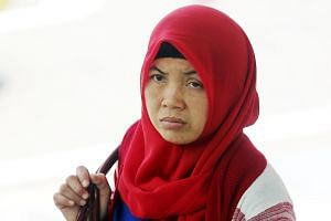 Ms Khanifah (above) had been working for Zariah Mohd Ali and Mohamad Dahlan for about six months when the alleged abuses took place. She told the court she was hit on the head with a hammer at least five times.