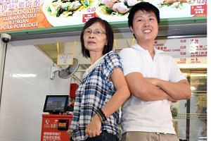Mr Ang, 29, with his mother Ling Ke Eng, 58, at his stall in the Ci Yuan hawker centre in Hougang. He is one of the 18 youngsters who graduated from Fei Siong Food Management's programme last year.