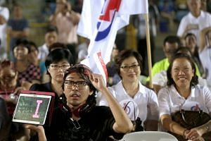 PAP supporters attending a rally at Bukit Gombak Stadium last Friday. Mr Murali has served in Bukit Batok for 16 years and is a familiar face in the area. This connection to the grassroots could give him a lift.