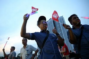 SDP supporters attending a campaign rally at a field in Bukit Batok Industrial Park A last Friday. Party candidate Chee Soon Juan is making his fifth attempt to enter Parliament.