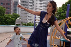 Ms Sylvia Huang tries to offer her son Noah, three, something more exciting to look forward to when he does not want to leave the playground.