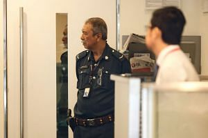 A Certis Cisco security guard at the StanChart branch in Holland Village yesterday, one day after a Caucasian man brazenly walked in around 11.25am, slipped the teller a piece of paper with his demands, then got away on foot with about $30,000 in cas