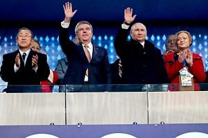 From left: United Nations Secretary- General Ban Ki Moon with IOC president Thomas Bach, Russian President Vladimir Putin, and other dignitaries during the opening ceremony of the 2014 Sochi Winter Olympics, where the host nation's elaborate method o