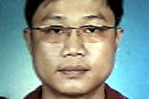 """Tan, dubbed the """"One-eyed Dragon"""", was found guilty of discharging a firearm and hanged in 2009. Ho, who remained at large for nine years, pleaded guilty to one charge of harbouring a fugitive."""