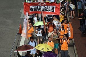 Organisers say about 1,300 supporters took part in the two-hour march from Causeway Bay to the chief executive's office in Admiralty district yesterday, but police put the turnout at 760.