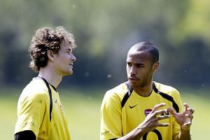 Jens Lehmann (far left) with Thierry Henry during an Arsenal training session back in 2006.