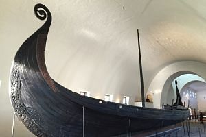 A centuries-old ship in Oslo's Vikingskiphuset.