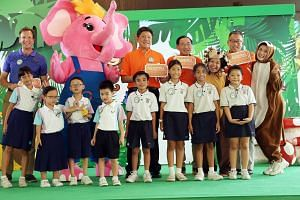 Celebrating Sharity Day at the River Safari with the mascot yesterday were (from left) Wildlife Reserves Singapore CEO Mike Barclay, Acting Minister for Education (Schools) Ng Chee Meng, Community Chest chairman Phillip Tan, vice-chairman Chew Kwee S